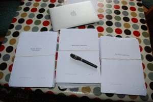 The latest three manuscripts for proofreading with my Visconti on top.